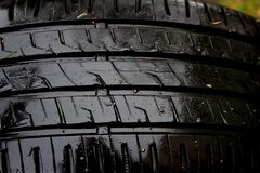 This is a detail of the wet summer tire. Royalty Free Stock Photo