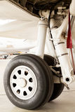 Detail of the wheel and landing gear on a jet Royalty Free Stock Photo
