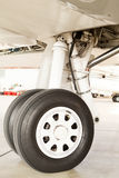 Detail of the wheel and landing gear on a jet Stock Images
