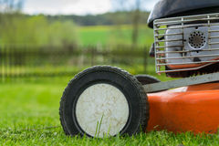 Detail of wheel and piece of motor of lawn mower (grass cutter) Stock Photos