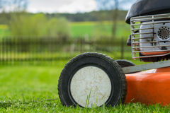 Detail of wheel and piece of motor of lawn mower (grass cutter) Stock Photography