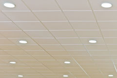 Ceiling with lightning. Detail of a white ceiling with integrated lightning royalty free stock photo