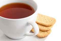 Detail of a white ceramic cup of rooibos tea with finger biscuit Royalty Free Stock Photography