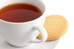 Detail of a white ceramic cup of rooibos tea with shortbread bis Royalty Free Stock Photo