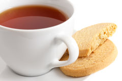 Detail of a white ceramic cup of rooibos tea with shortbread bis Royalty Free Stock Photos