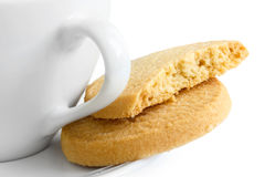 Detail of a white ceramic cup with shortbread biscuits. Detail of a white ceramic cup with shortbread biscuits Stock Image