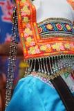 Detail of ethnic minorities costume. Detail of white hat of ethnic minorities costume from china stock images