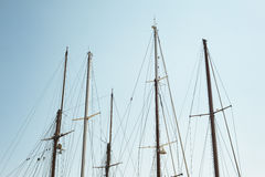 Detail of white masts of a boat with blue sky at the background Stock Photo