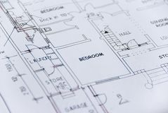 Detail of white sheet of building plans Royalty Free Stock Photos