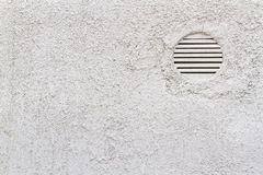 Detail of White Wall with Ventilation Grilles. Including copy space Stock Image