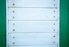 Detail of white wooden wall with green edges Stock Photos