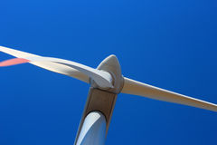 Detail of a wind turbine against clear blue sky Royalty Free Stock Image