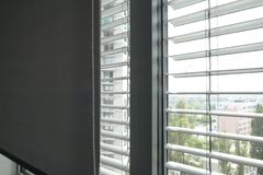 Detail of a window blinder in an office building. A detail of a window blinder in an office building Royalty Free Stock Photography
