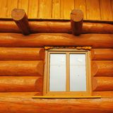 Detail of window built in wooden beams cabin wall Stock Photo