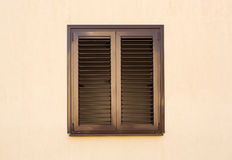 Detail of a window with shutters closed Royalty Free Stock Photos