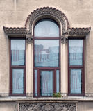 Detail of windows and balcony. Architectural detail of windows and balcony Stock Photo