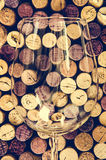 Detail of wine glass and corks in filtered old vintage style Royalty Free Stock Photography