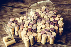 Detail of wine glass on corks in filtered old vintage style. Detail of empty wine glass on corks in filtered old vintage style royalty free stock image