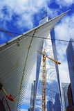 Detail of wing of WTC Transportation Hub and Freedom Tower. New York, USA - April 24, 2015: Detail of wing of WTC Transportation Hub and Skyscrapers and Freedom Royalty Free Stock Photos