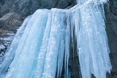 Icefall on a rock wall. Detail of a winter landscape, icefall on a rock wall royalty free stock image