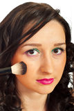 Detail of woman blushing. Detail of woman face  blushing cheeks over whte background Royalty Free Stock Photography