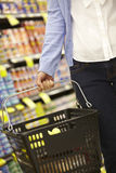 Detail Of Woman Carrying Shopping Basket In Supermarket Royalty Free Stock Photos