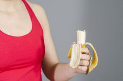 Detail of woman eating a Banana after did sport. Stock Photo