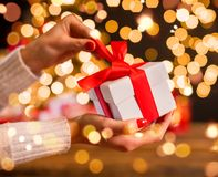 Detail of woman hand unwrapping Christmas gift Royalty Free Stock Image