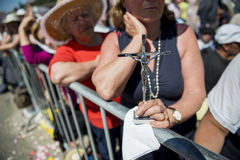 Detail of a woman holding a crucifix at the Sanctuary of Fatima during the celebrations of the apparition of the Virgin Mary in Fa. Fatima, Portugal - May 13 Royalty Free Stock Photography