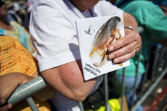 Detail of a woman holding an image at the Sanctuary of Fatima during the celebrations of the apparition of the Virgin Mary in Fati. Fatima, Portugal - May 13 Stock Image