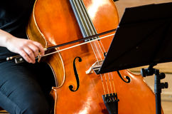 Detail of a woman playing cello Royalty Free Stock Images