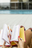 Detail of a woman reading a book Royalty Free Stock Image