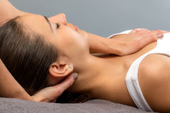 Detail of woman receiving physical neck therapy. Stock Images