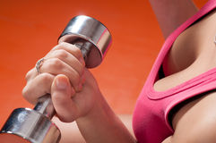 Detail of woman's hand exercising with dumbbell Stock Photos