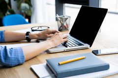 Detail of woman`s hand typing on a laptop keyboard. royalty free stock images