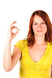 Detail of a woman showing OK sign. Detail of a beautiful red-haired woman showing the OK sign on white background stock image
