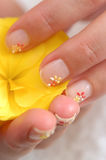 Detail of women nail and flowe Stock Photo
