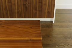 Detail of wood dining table grain against floor and cabinet Stock Images