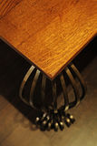 Detail of wood table with metal legs. royalty free stock photography