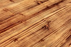 Detail on wooden boards, grain of wood enhanced by burning. stock photo