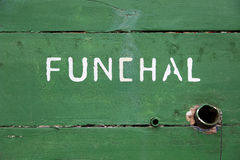 Detail of a wooden boat with Funchal written on it Stock Photography