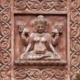 Detail wooden carved door in hindu temple, Kathmandu, Nepal background. Close up Stock Image