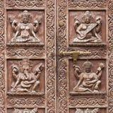 Detail wooden carved door in hindu temple, Kathmandu, Nepal background. Close up Royalty Free Stock Image