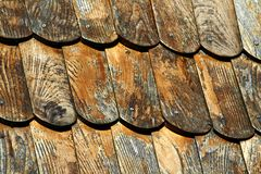 Detail of wooden clapboard roof with steel drive screws. Slightly faded lacquer finish royalty free stock photography