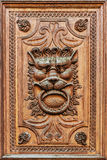 Detail of wooden door. Detail of historic wooden door with a lion Royalty Free Stock Image