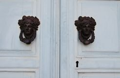 Woman`s head door knockers royalty free stock images