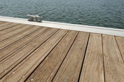 Floating dock. Detail of a wooden floating dock with mooring bitts Stock Photos
