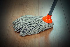 Detail of wooden floor cleaning with mop Stock Images