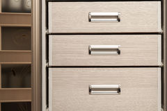 Detail of wooden furniture cabinet chest with drawers front, met Stock Images