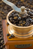 Detail of wooden hand coffee grinders. Detail of wooden coffee hand mill with coffee beans Royalty Free Stock Photos